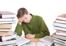 El estudiante durmiente con los libros aislados Imágenes de archivo libres de regalías
