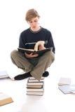 El estudiante joven aislado en un blanco Foto de archivo