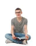 El estudiante joven con el libro Imagen de archivo libre de regalías