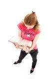 El estudiante joven con libros aislados en un blanco Fotos de archivo libres de regalías