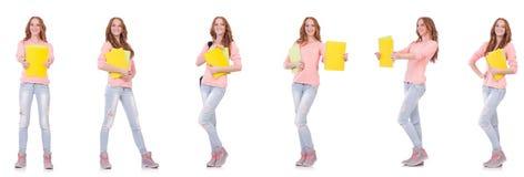 El estudiante joven con los cuadernos aislados en blanco Foto de archivo libre de regalías