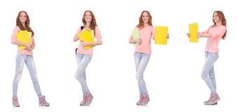 El estudiante joven con los cuadernos aislados en blanco Imagen de archivo