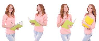 El estudiante joven con los cuadernos aislados en blanco Imagenes de archivo