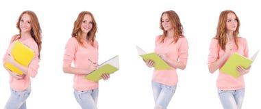 El estudiante joven con los cuadernos aislados en blanco Fotografía de archivo
