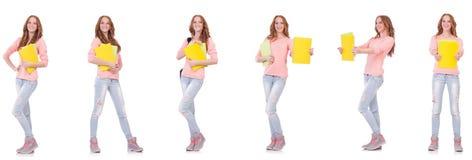 El estudiante joven con los cuadernos aislados en blanco Foto de archivo