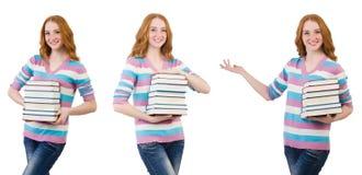 El estudiante joven con los libros aislados en blanco Fotos de archivo
