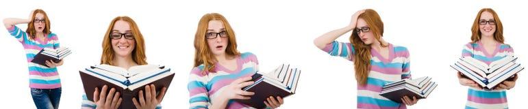 El estudiante joven con los libros aislados en blanco Imagen de archivo