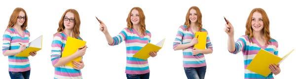 El estudiante joven con los libros aislados en blanco Imagen de archivo libre de regalías