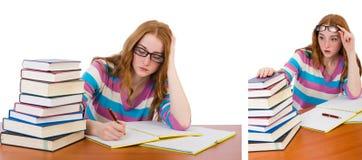 El estudiante joven con los libros aislados en blanco Fotografía de archivo libre de regalías