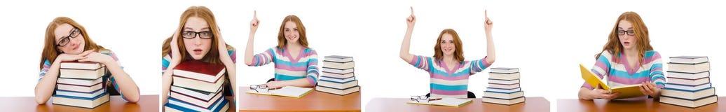 El estudiante joven con los libros aislados en blanco Fotos de archivo libres de regalías