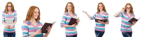 El estudiante joven con los libros aislados en blanco Foto de archivo libre de regalías