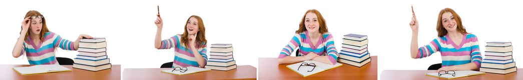 El estudiante joven con los libros aislados en blanco Imagenes de archivo