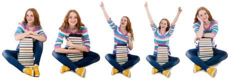 El estudiante joven con los libros aislados en blanco Fotografía de archivo