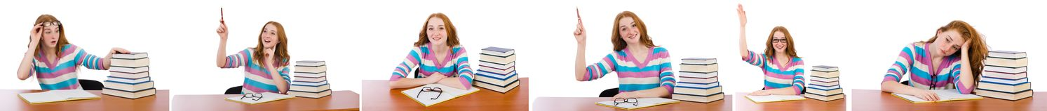 El estudiante joven con los libros aislados en blanco Imágenes de archivo libres de regalías