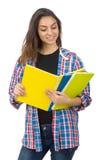 El estudiante joven con los libros de texto aislados en blanco Fotos de archivo libres de regalías
