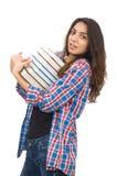El estudiante joven con los libros de texto aislados en blanco Foto de archivo
