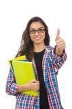El estudiante joven con los libros de texto aislados en blanco Fotografía de archivo libre de regalías