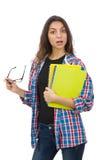 El estudiante joven con los libros de texto aislados en blanco Fotos de archivo