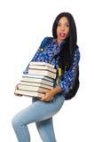 El estudiante joven con los libros en blanco Fotografía de archivo libre de regalías