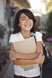 El estudiante joven feliz está apagado a la escuela imagenes de archivo