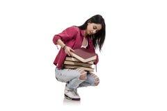 El estudiante joven femenino con los libros aislados en blanco Fotografía de archivo