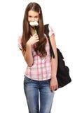 El estudiante lindo huele una flor Fotos de archivo libres de regalías
