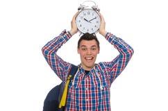 El estudiante que sostiene el despertador aislado en blanco Imagen de archivo