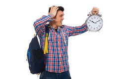 El estudiante que sostiene el despertador aislado en blanco Imágenes de archivo libres de regalías