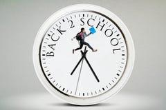 El estudiante salta en el reloj Fotos de archivo libres de regalías