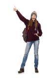 El estudiante sonriente con la mochila aislada en blanco Imagen de archivo