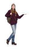 El estudiante sonriente con la mochila aislada en blanco Fotografía de archivo libre de regalías