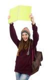 El estudiante sonriente con la mochila y el libro aislados en blanco Imagen de archivo libre de regalías