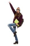 El estudiante sonriente con la mochila y el libro aislados en blanco Imagenes de archivo