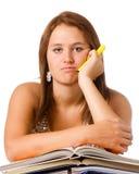 El estudiar adolescente infeliz agujereado de la muchacha de la escuela Fotos de archivo libres de regalías