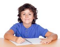 El estudiar del niño del estudiante Fotos de archivo