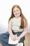 El estudiar feliz del adolescente Foto de archivo libre de regalías