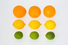 3 naranjas 3 limones 3 frutas de la cal Fotos de archivo libres de regalías