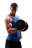 El estudio tiró de barbell de elevación muscular del hombre joven Foto de archivo