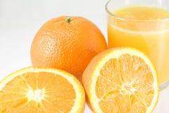 Naranjas con el jugo Foto de archivo libre de regalías