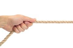 Sola cuerda de tracción de la mano en el fondo blanco Imagen de archivo libre de regalías