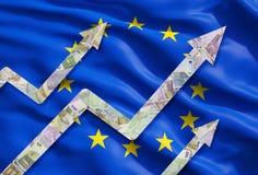El euro cada vez mayor observa flechas sobre la bandera de la unión europea Fotografía de archivo