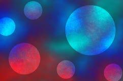 El extracto oscuro y ligero azul y rojo circunda el fondo Imagen de archivo libre de regalías