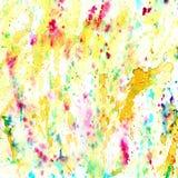 El extracto salpicó y salpicó manchas del amarillo colorido Fotografía de archivo