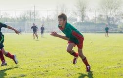 El fútbol de los niños Foto de archivo libre de regalías