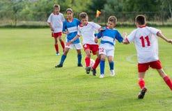 El fútbol del niño Fotografía de archivo libre de regalías