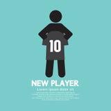 El fútbol/el jugador de fútbol que muestra una camisa Foto de archivo