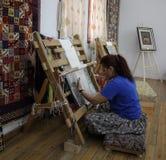 El fabricante de la alfombra Imagen de archivo