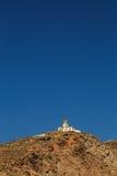 El faro de Akrotiri en Santorini Imagen de archivo
