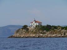 El faro de Plocica en el mar adriático de Croacia Fotografía de archivo