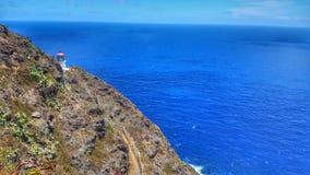 El faro a lo largo del Makapu' rastro de u en Oahu, Hawaii foto de archivo